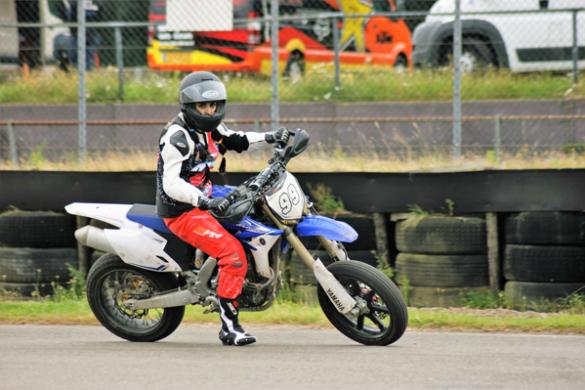 Beauty Biker riding a supermotor